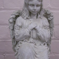 Small angel kneeling